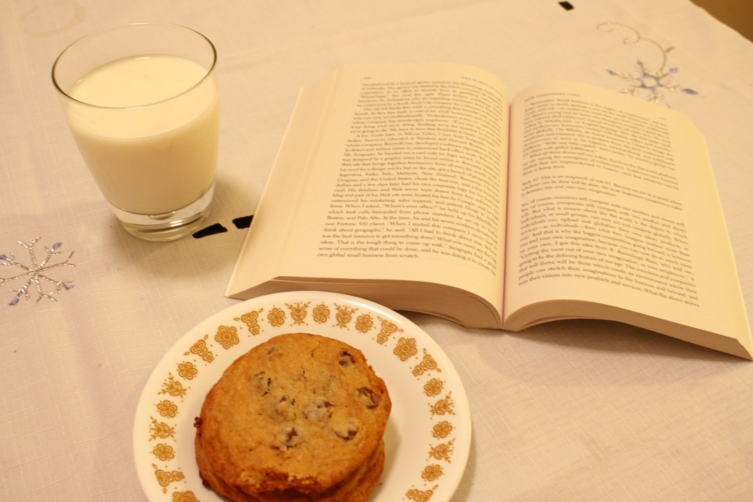 chocolate chip cookies, milk, and a book